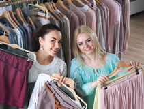 Girls choosing clothes Royalty Free Stock Photo