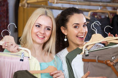 Girls choosing clothes Stock Photography