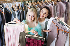 Girls choosing new garment Royalty Free Stock Images