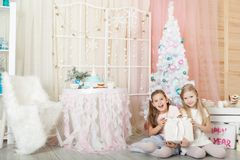 Girls in a Christmas decorations Royalty Free Stock Photo