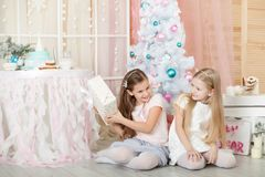 Girls in a Christmas decorations Royalty Free Stock Photos