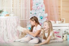 Girls in a Christmas decorations Stock Photos
