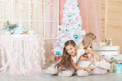 Girls in a Christmas decorations Stock Images
