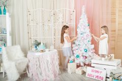Girls in a Christmas decorations Royalty Free Stock Image