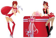 Girls with christmas gifts Stock Images