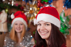 Girls in Christmas hats Stock Image
