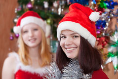 Girls in  Christmas hats Royalty Free Stock Photos