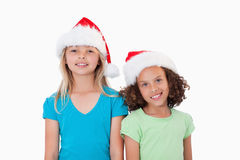 Girls with Christmas hats Royalty Free Stock Image