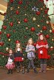Girls and christmas-tree Stock Photos