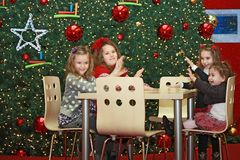 Girls and christmas-tree Stock Photography