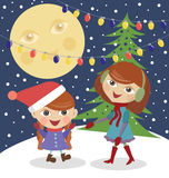 Girls and Christmas tree Royalty Free Stock Photo