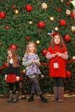 Girls by the Christmas tree Stock Images
