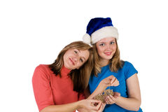 Girls with Christmas tree balls Stock Photos