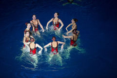 The girls in a circle in pool at Show Olympic champions Stock Photography