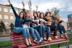 Girls in a city park on a bench Stock Image