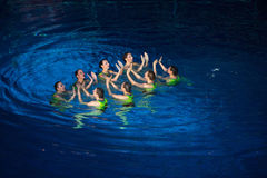 The girls clap their hands in pool Royalty Free Stock Images