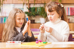 Girls on classroom. Two happy girls on classroom Royalty Free Stock Images