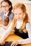 Girls at classroom Stock Image