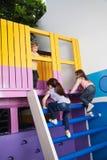 Girls Climbing Playhouse Ladder Stock Image
