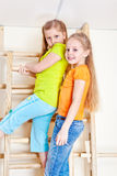 Girls climbing wall bars Royalty Free Stock Photography