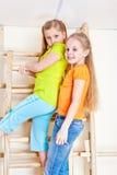 Girls climbing wall bars Royalty Free Stock Photography
