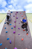 Girls on climbing wall Royalty Free Stock Photography
