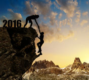 Girls climbs into the New Year 2016. Stock Photos