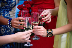 Girls clinking glasses of champagne at the party Stock Images