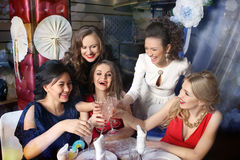 Girls clinking glasses of cocktails at the party Royalty Free Stock Photography
