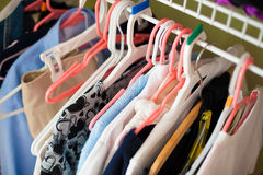 Girls closet. Photo of children clothes hanging in a closet Stock Image