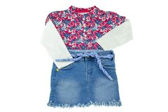 Girls clothes. Fashionable little girl shirt with floral print a stock photos
