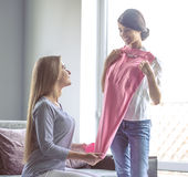 Girls with clothes Royalty Free Stock Photography