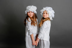 Girls clothing rustic vintage on a gray background. Holding hands Royalty Free Stock Photography