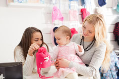 Girls in a clothing store Royalty Free Stock Image