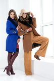 Girls in coats posing at stidio Royalty Free Stock Photography