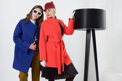 Girls in coats posing at stidio Royalty Free Stock Images
