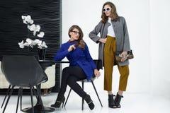 Girls in coats posing at stidio Stock Photo