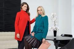 Girls in coats posing at stidio Stock Photos
