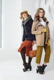 Girls in coats posing at stidio Royalty Free Stock Photo