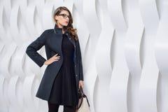 Girls in coats posing at stidio Royalty Free Stock Image