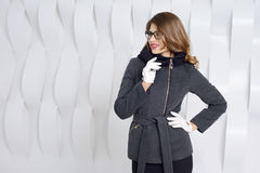 Girls in coats posing at stidio Stock Photography