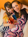 Girls with cocktails Stock Photography