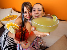 Girls with cocktails Stock Images