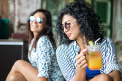 Girls with cocktails Royalty Free Stock Photo