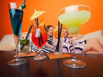 Girls with cocktails Stock Image