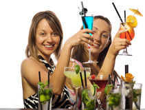 Girls with cocktails Royalty Free Stock Photography