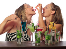 Girls with cocktails Royalty Free Stock Image