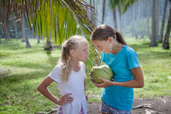Girls with coconut Stock Photography