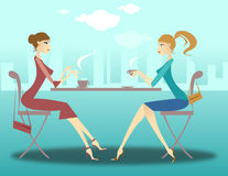 Girls at the coffee. Girls talking and drinking coffee outside Stock Photos