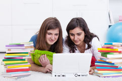 Girls in college. Friends in college together - beautiful girls study with books and laptop Royalty Free Stock Photography